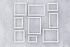 Cornici bianche su un muro di mattoni Fotografia Stock Libera da Diritti