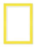 Cornici di legno Isolato su fondo bianco, colo giallo Fotografia Stock