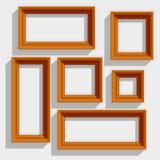 Cornici di legno vuote di Brown isolate sul Fotografia Stock Libera da Diritti