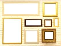 Cornici vuote sul muro di mattoni Fotografia Stock