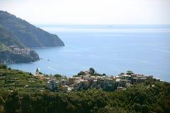Corniglia of Cinque Terre, Italy. On a sunny day Stock Photos
