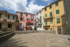 Corniglia, place in front of the church. Narrow place in front of the church San Pietro.Corniglia is one of five famous villages of Cinque Terre, suspended royalty free stock image