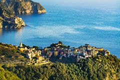 Corniglia village and Manarola in background at sunset. Cinque T Royalty Free Stock Photo