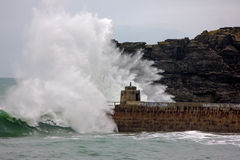 Cornish coast gets battered by storms. Portreath pier gets battered by winter storm swell Stock Photo