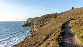 Cornish coastal path, in the summer, with a derelict tin mine in the distance stock photo