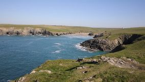 Cornish cove Porth Joke Cornwall England UK near Newquay and Crantock stock footage