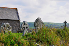 Cornish Crosses, Churchyard, Tintagel, Cornwall. Cornwall and the legend of King Arthur are closely linked. Cornwalls claim to the story centres on the ancient Royalty Free Stock Photo
