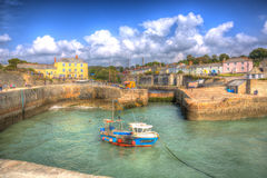 Cornish harbour Charlestown near St Austell Cornwall England UK with clear blue sea in HDR. Cloudscape and harbour Charlestown near St Austell Cornwall England Stock Images