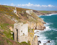 Cornish mines on the cliffs. The dramatically located engine houses of Trewavas Head Mine Cornwall, part of the Cornish Mining World Heritage Site Stock Photo
