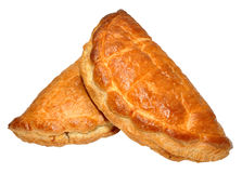 Cornish Pasties. Two traditional Cornish pasties, isolated on a white background Stock Image