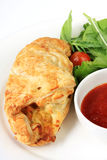 Cornish Pasty. With salad and sauce.  This is a type of vegetarian pie from Cornwall, also popular in Australia Royalty Free Stock Image
