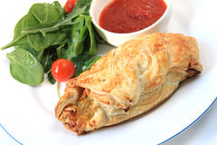 Cornish Pasty. And salad, with a chili dipping sauce.  A modern variation on this traditional Cornish miners' vegetable pie Royalty Free Stock Photo
