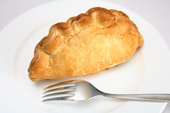 Cornish pasty. Traditional Cornish pasty, filled with meat, onion and potato, these have become a favourite snack across Britain Royalty Free Stock Images