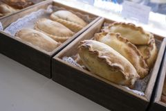 Cornish pasty in bakers shop, showing two kinds of pasty. Cornish pasty in bakers shop. A favourite british snack, the pasty is originally from Cornwall and is royalty free stock image