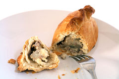 Cornish pasty broken open and fork Stock Photo