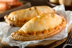 Cornish Pasty. Delicious homemade Cornish pasties with beef, carrot, and potato Royalty Free Stock Photo