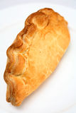 Cornish pasty on a plate. Traditional Cornish pasty; filled with meat, onion and potato, these have become a favourite snack across Britain Stock Photo