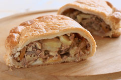 Cornish pasty. Traditional Cornish pasty filled with meat potato swede and carrots Stock Photos