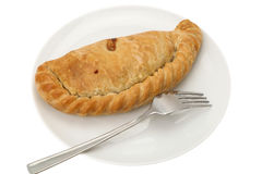 Cornish Pasty. Traditional Cornish pasty served on a white plate with a fork - white background Royalty Free Stock Photos
