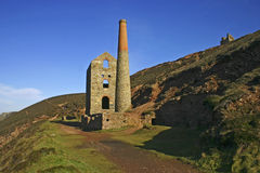 Cornish tin mine agaist blue s Stock Photography