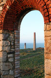 Cornish Tin Mines. Abandoned tin mines near Botallack, Cornwall. Focus on chimneys in the distance Royalty Free Stock Photography