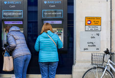 Cornmarket Street, Oxford, United Kingdom, January 22, 2017: Cus. Tomers using a Barclays Bank ATM Bancomats Free Cash Withdrawals at the branch on Cornmarket Royalty Free Stock Photo