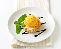 Cornmeal and almond cookie with ice cream Royalty Free Stock Photography