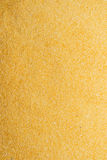 Cornmeal. Background of yellow cornmeal spanning the entire image Royalty Free Stock Images