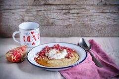 Cornmeal and greek yogurt breakfast with pomegranate Royalty Free Stock Image