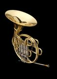 Corno. Big musical instrument horn on black background royalty free stock photography