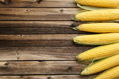 Corns. On a brown wooden background Stock Images