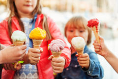 5 corns of colorful ice cream. Holding by kids Royalty Free Stock Photo
