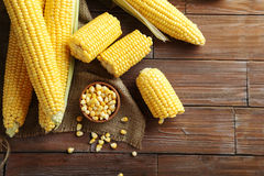 Corns. Sweet corns on a brown wooden table Royalty Free Stock Photography