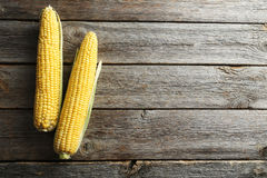 Corns. Sweet corns on a grey wooden table Royalty Free Stock Images