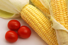 Corns and tomatoes Stock Photos