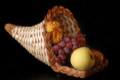 Cornucopia. A cornucopia filled with fruit and vegetables stock image