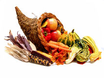 Cornucopia. A harvest or thanksgiving cornucopia filled with gourdes, dried corn, vegetables and colorful autumn leaves Royalty Free Stock Photos