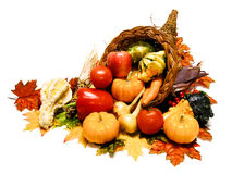 Cornucopia. Harvest or Thanksgiving cornucopia filled with wide selection of vegetable over a white background Stock Image