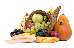 Cornucopia. A autumn horn of plenty. Cornucopia full of fruits and vegetables royalty free stock image