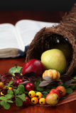 Cornucopia and the Bible. Thanksgiving arrangement with cornucopia and the Bible in background Royalty Free Stock Photo