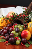 Cornucopia and the Bible. Thanksgiving arrangement with cornucopia and the Bible in background Stock Photography