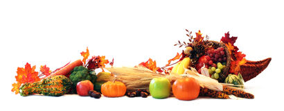 Cornucopia border. Thanksgiving cornucopia filled with autumn fruits and vegetables spread out to create a border
