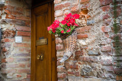 Cornucopia. With flowers, somewhere in the medieval town Lucignano in Tuscany, Italy royalty free stock images
