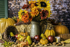 Cornucopia. Thanksgiving cornucopia of fruits nuts pumpkins fall flowers and autumn leaves Stock Image