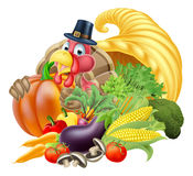 Cornucopia and Thanksgiving Turkey. Thanksgiving golden horn of plenty cornucopia full of vegetables and fruit produce with cartoon turkey bird wearing a pilgrim Stock Photos