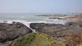 Cornwall coast and Godrevy lighthouse England UK stock video