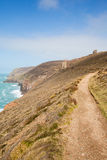 Cornwall coast path and tin mine England UK Royalty Free Stock Images
