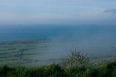 Cornwall coastal moorland with foggy mist cloud sea in distance Stock Photo