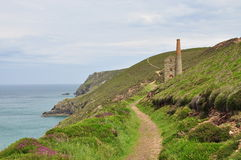 Cornwall coastal path, old mines. England, UK Stock Photos
