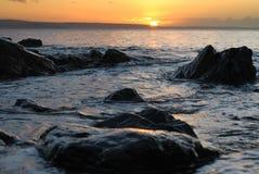 Cornwall sunrise across rocks and sea Stock Photos